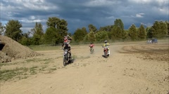 FMX lap and jump, 3 riders Stock Footage