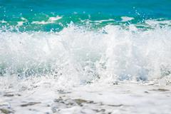 clean sea water is removed close up on the shore - stock photo