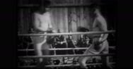 Military officers watching and cheering military soldiers boxing Stock Footage