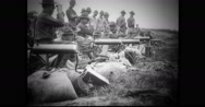 Military soldiers practicing firing with machine gun Stock Footage
