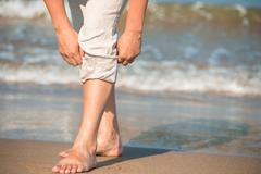 Barefoot male tuck pants not to wet Stock Photos