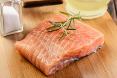 Fresh raw salmon filet on wooden cutting board Stock Photos