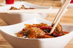 Sweet and sour pork and rice in a bowl Stock Photos