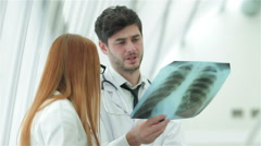 Confident doctor examining x-ray snapshot of lungs - stock footage