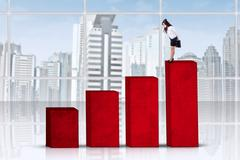 Stock Illustration of businesswoman looking at the lower chart