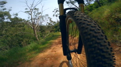 4k timelapse video of mountain biking on a dirt road Stock Footage