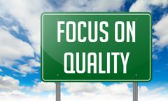 Stock Illustration of Focus on Quality in Green Highway Signpost.