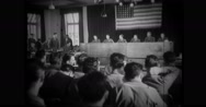 Military officer speaking to judges in court room Stock Footage
