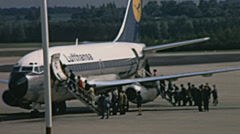Vienna 1969: people boarding a Lufthansa aircraft - stock footage