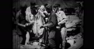 Clothing are issued to liberated men Stock Footage