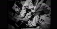 Shoes are issued to liberated men Stock Footage