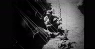 Filipino civilians sitting in shade Stock Footage