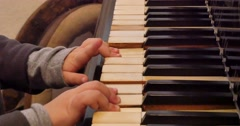 4K video of child hands playing mellow tune on old piano - stock footage