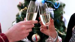 Stock Video Footage of New Year Clinking Champagne Glasses witn Christmass tree