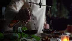 Stock video footage herbal medicine quacksalver  prepares a  potion slow motion Stock Footage