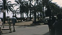 Lloret de Mar 1969: palms boulevard on the waterfront Stock Footage