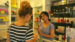 Girl Chooses Makeup at the Cosmetics and Beauty Shop with Assistant. Stock Footage