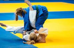 Fighter girl in judo Kuvituskuvat