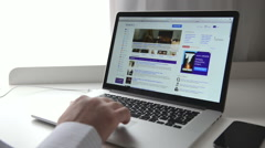 Yahoo! webpage on macbook Stock Footage