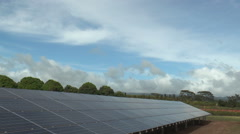 Solar panels power plant in hawaii driving shot Stock Footage