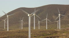 Energy producing wind turbines on ocean shore, Tenerife, Canary islands. Stock Footage