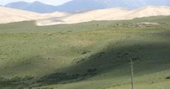 4k far away Desert & grassland scenery,plateau landform,cloud shadow rolling ov Stock Footage