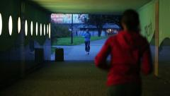 People jogging through the tunel in the city in the evening HD Stock Footage
