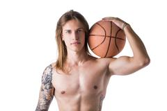 long haired shirtless man with basketball ball - stock photo