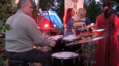 Man with drum beat rhythm and women sing national folk song Stock Footage