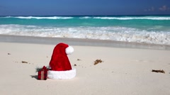 Santa Hat and present box on beach Stock Footage
