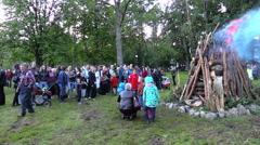 People enjoy huge fire place in Feast of St John Stock Footage