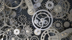 Background with metal cogwheels a clockwork. Macro, extreme closeup - stock footage
