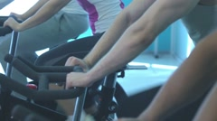 People doing exercise on the exercise bike Stock Footage