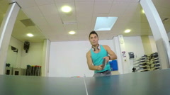 Young East Asian man celebrating winning in table tennis Stock Footage