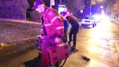 Rescue crews carrying a stretcher forward while doing CPR on trauma victim Arkistovideo