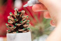 Hand working on christmas decoration Stock Photos