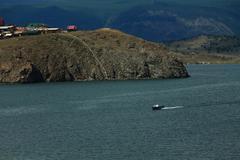 small speedboat near shore of Baikal lake - stock photo