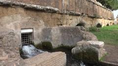 Water flows beneath Acqua Felice, Roman Aqueduct 4k Stock Footage