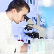 Health care professional in lab. - stock photo
