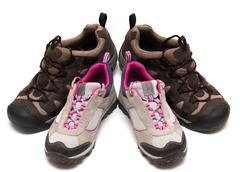 two pairs of trekking shoes - stock photo