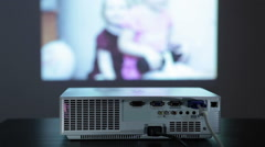 Digital projector in work, showing photo pictures on the wall, small screen Stock Footage