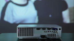 Digital projector in work, showing photo pictures on the wall, wide screen - stock footage