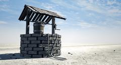 wishing well with wooden bucket on a barren landscape - stock illustration