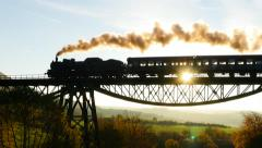 beautiful nostalgic view of steam locomotive train silhouette at sunset sky - stock footage