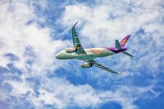 thai airways plane in sky - stock photo