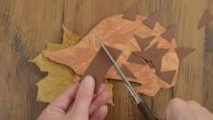 Cutting bristles to craft hedgehog of paper Stock Footage