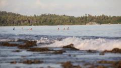 View of coral reef with surfers waiting for waves Stock Footage
