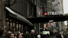 Holiday Shoppers Walk Next to the Macy's Flagship Store in New York Stock Footage