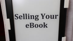 "EBook Kindle Reader Camera Move (Dolly/Slide)  - ""Selling Your eBook"" Stock Footage"