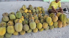 Vendors selling durian fruit in the street Stock Footage
